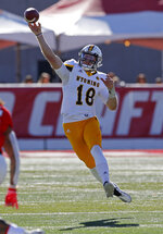 Wyoming quarterback Tyler Vander Waal (18) throws a pass against New Mexico during the first half of an NCAA college football game in Albuquerque, N.M., Saturday, Nov. 24, 2018. (AP Photo/Andres Leighton)
