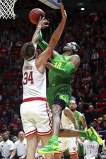 Utah center Jayce Johnson (34) blocks the shot of Oregon forward Kenny Wooten (14) during the first half of an NCAA college basketball game Thursday, Jan. 31, 2019, in Salt Lake City. (AP Photo/Chris Nicoll)