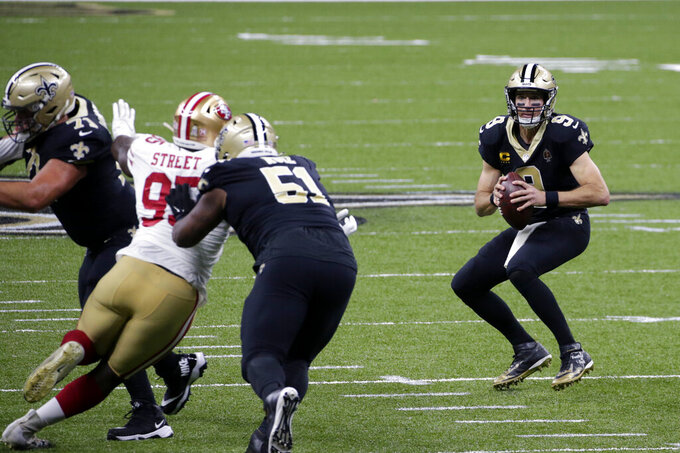 San Francisco 49ers defensive end Kentavius Street (95) is seen blowing past New Orleans Saints rookie center Cesar Ruiz (51) on his way to sack quarterback Drew Brees (9) in the first half of an NFL football game in New Orleans, Sunday, Nov. 15, 2020. Brees has been diagnosed with multiple rib fractures and a collapsed right lung, a person with knowledge of the situation said Monday, from the heavy hit on the play. (AP Photo/Butch Dill)