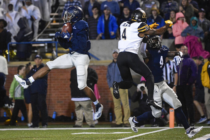 Georgia Southern safety Darrell Baker Jr. intercepts a pass intended for Appalachian State wide receiver Dominique Heath (4) as cornerback Monquavion Brinson, right, also defends during the first half of an NCAA college football game, Thursday, Oct. 25, 2018, in Statesboro, Ga. (AP Photo/John Amis)