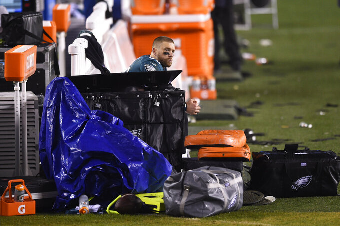 Philadelphia Eagles' Zach Ertz lingers on the bench after an NFL football game against the Washington Football Team, Sunday, Jan. 3, 2021, in Philadelphia. (AP Photo/Derik Hamilton)