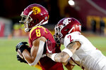 Southern California wide receiver Amon-Ra St. Brown, left, catches a touchdown pass against Washington State defensive back Derrick Langford during the first half of an NCAA college football game in Los Angeles, Sunday, Dec. 6, 2020. (AP Photo/Alex Gallardo)