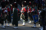 Pipe band members prepare to march in the Anzac Day parade in Sydney, Australia, Sunday, April 25, 2021. Australians and New Zealanders paid tribute to their war dead Sunday as both nations prepared to withdraw from their longest war in Afghanistan. (AP Photo/Mark Baker)