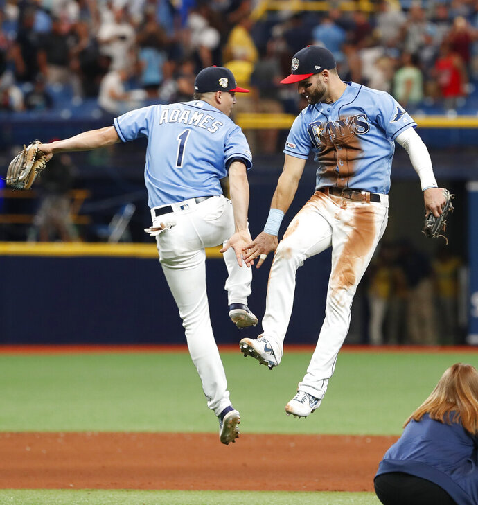 Tampa Bay Rays Kevin Kiermaier, right, celebrates with teammate Willy Adames after defeating the New York Yankees during their baseball game Sunday July 7, 2019, in St. Petersburg, Fla. (AP Photo/Scott Audette)