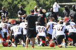 Cincinnati Bengals' head coach Zac Taylor, center, talks with his team after an NFL football camp practice in Cincinnati, Monday, Aug. 17, 2020. (AP Photo/Aaron Doster)