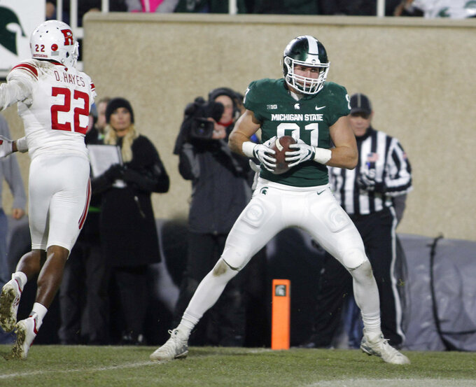 Michigan State tight end Matt Sokol, right, catches a pass for a touchdown against Rutgers' Damon hayes (22) during the second quarter of an NCAA college football game, Saturday, Nov. 24, 2018, in East Lansing, Mich. (AP Photo/Al Goldis)
