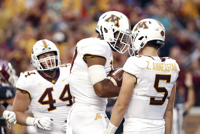 Minnesota tight end Seth Green (17) celebrates with quarterback Zack Annexstad (5) after the team scored a touchdown against New Mexico State during the first half of an NCAA college football game Thursday, Aug. 30, 2018, in Minneapolis. (AP Photo/Stacy Bengs)