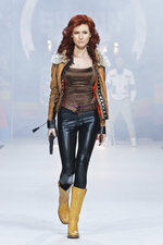 FILE. In this file photo taken on Sunday, April 3, 2011, Anna Chapman, who was deported from the U.S. on charges of espionage, displays a creation by Russian designers Shiyan & Rudkovskaya during a Fashion Week in Moscow, Russia. Chapman, one of 10 Russian sleeper agents rounded up by the FBI in 2010 and sent home in a spy swap, became the host of