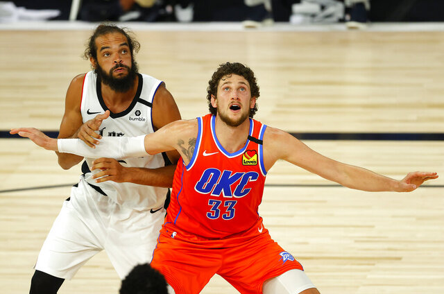 Oklahoma City Thunder's Mike Muscala (33) and Los Angeles Clippers' Joakim Noah, left, battle for position during the third quarter of an NBA basketball game Friday, Aug. 14, 2020, in Lake Buena Vista, Fla. (Mike Ehrmann/Pool Photo via AP)