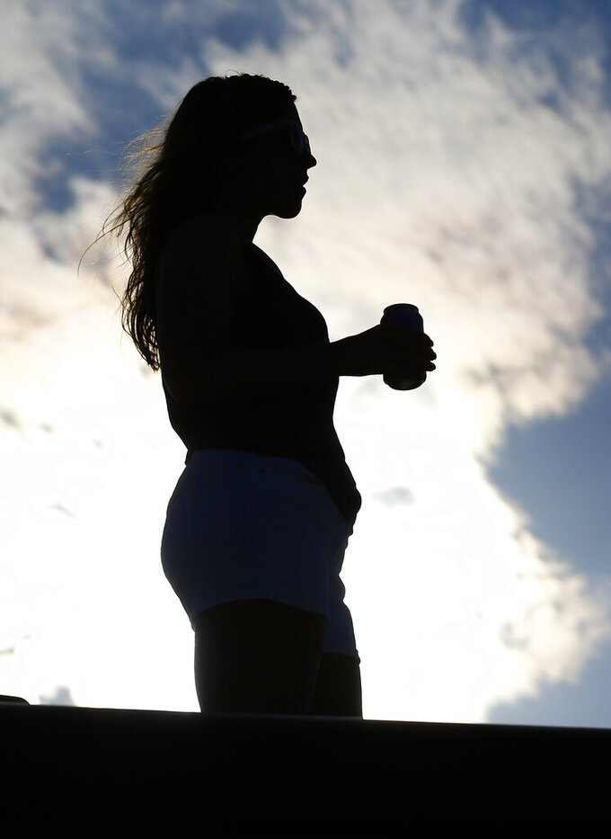 A fan looks over the infield as they get ready for the Geico 500 at Talladega Superspeedway, Sunday, April 28, 2019, in Talladega, Ala. (AP Photo/Butch Dill)