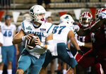Coastal Carolina quarterback Grayson McCall (10) rolls out to attempt a pass during the first half of an NCAA football game against Louisiana-Lafayette in Lafayette, La., Wednesday, Oct. 14, 2020. (AP Photo/Paul Kieu)