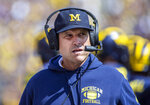 FILE - In this Saturday, Sept. 7, 2019. file photo,Michigan head coach Jim Harbaugh wears his headset on the sidelines in the first quarter of an NCAA football game against Army in Ann Arbor, Mich. Michigan is heading into the first really big Big Ten game of the season. The Wolverines face No.  13 Wisconsin in Madison on Saturday, Sept. 21, 2019.  (AP Photo/Tony Ding, File)
