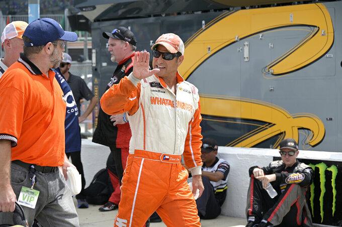 Driver David Starr walks to his vehicle on pit road before a NASCAR Xfinity Series auto race at Daytona International Speedway, Saturday, Aug. 28, 2021, in Daytona Beach, Fla. (AP Photo/Phelan M. Ebenhack)