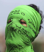 FILE- In this Friday, Aug. 30, 2019, file photo, a masked Kashmiri protester shouts freedom slogans in Srinagar, Indian controlled Kashmir. Frustration, anger and fear have been growing in Kashmir in the five weeks since the Hindu nationalist government of Prime Minister Narendra Modi stripped the region of most of its semiautonomous status on Aug. 5 and imposed a curfew and a communications blackout. Although some restrictions have been eased in the main city of Srinagar, with students encouraged to return to school and businesses to reopen, rural residents complain of what they perceive as a campaign of violence and intimidation that seems designed at suppressing any militancy, rebellion or dissent. (AP Photo/Mukhtar Khan, File)