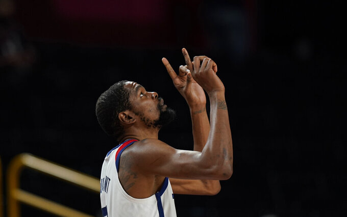 United States' Kevin Durant (7) reacts at the start of the men's basketball gold medal game between France and the United States at the 2020 Summer Olympics, Saturday, Aug. 7, 2021, in Saitama, Japan. (AP Photo/Eric Gay)