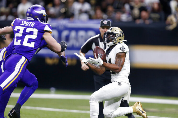 New Orleans Saints wide receiver Deonte Harris pulls in a 50-yard pass play in front of Minnesota Vikings free safety Harrison Smith (22) in the first half of an NFL wild-card playoff football game, Sunday, Jan. 5, 2020, in New Orleans. (AP Photo/Butch Dill)