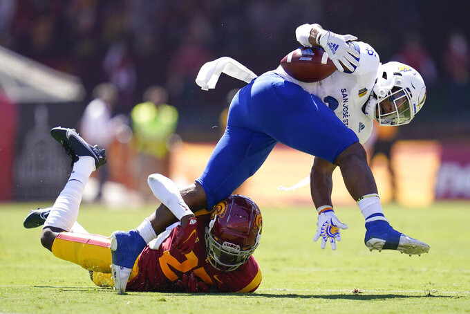 Southern California safety Calen Bullock, left, tackles San Jose State running back Tyler Nevens during the first half of an NCAA college football game Saturday, Sept. 4, 2021, in Los Angeles. (AP Photo/Ashley Landis)