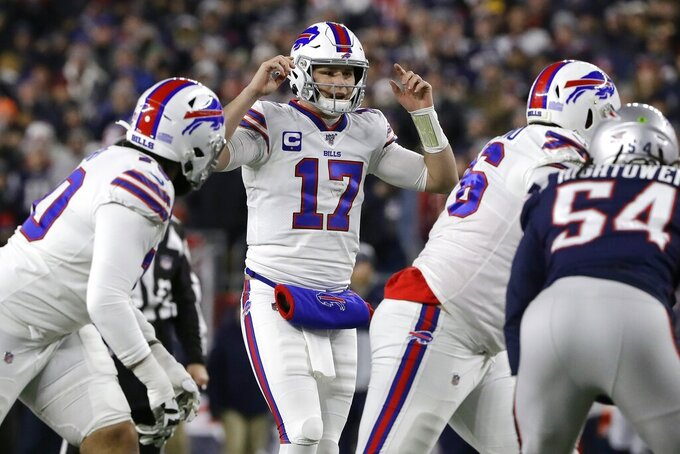 Buffalo Bills quarterback Josh Allen calls signals at the line of scrimmage in the first half of an NFL football game against the New England Patriots, Saturday, Dec. 21, 2019, in Foxborough, Mass. (AP Photo/Steven Senne)