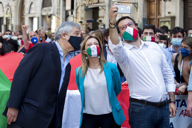 From left, Forza Italia party's Antonio Tajani, Brothers of Italy Party's leader Giorgia Meloni and The League party leader Matteo Salvini take a selfie during an anti-government protest in Rome, Tuesday, June 2, 2020 on the day marking the 74th anniversary of the Italian Republic. (Roberto Monaldo/LaPresse via AP)
