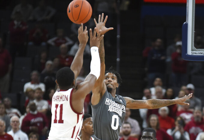 Mississippi State guard Nick Weatherspoon (0) tries to stop a shot by Oklahoma guard De'Vion Harmon (11) during the second half of an NCAA college basketball game in Oklahoma City, Saturday, Jan. 25, 2020. (AP Photo/Kyle Phillips)