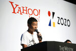 Zozo founder and Chief Executive Yusaku Maezawa speaks during a news conference Thursday, Sept. 12, 2019, in Tokyo. Yahoo Japan Corp. is putting up a tender offer, estimated at 400 billion yen ($3.7 billion), for Zozo Inc., a Japanese online retailer started by the celebrity tycoon. (AP Photo/Jae C. Hong)