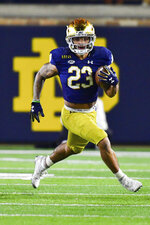 Notre Dame running back Kyren Williams carries against Clemson during the third quarter of an NCAA college football game Saturday, Nov. 7, 2020, in South Bend, Ind. (Matt Cashore/Pool Photo via AP)
