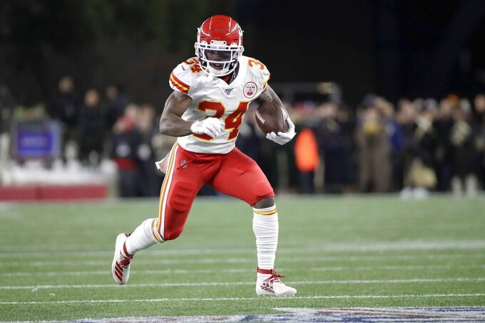 Kansas City Chiefs running back Darwin Thompson carries the ball against the New England Patriots in the first half of an NFL football game, Sunday, Dec. 8, 2019, in Foxborough, Mass. (AP Photo/Elise Amendola)
