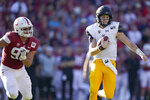 California quarterback Chase Garbers (7) scrabbles away from Stanford linebacker Gabe Reid (90) during the first half of an NCAA college football game Saturday, Nov. 23, 2019 in Stanford, Calif. (AP Photo/Tony Avelar)