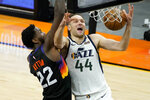 Utah Jazz forward Bojan Bogdanovic (44) shoots over Phoenix Suns center Deandre Ayton (22) during the second half of an NBA basketball game, Wednesday, April 7, 2021, in Phoenix. (AP Photo/Matt York)