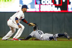Seattle Mariners' Mallex Smith steals second base as Minnesota Twins shortstop Jorge Polanco misses the ball on a throwing error by catcher Mitch Garver during the eighth inning of a baseball game Wednesday, June 12, 2019, in Minneapolis. Smith advanced to third. (AP Photo/Bruce Kluckhohn)