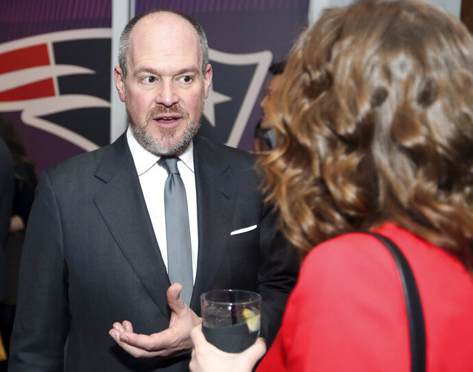 """FILE - In this Feb. 2, 2018 file photo Rich Eisen talks to guests at the NFLN Super Bowl LII media party in Minneapolis. Eisen's weekday talk show will have a new home for the next two months. NBC Sports Network announced on Wednesday, April 8, 2020 that """"The Rich Eisen Show"""" will air on the channel beginning Monday at 1 p.m. ET. That will be the last two hours of the show, which begins at noon on a network of national radio affiliates, including Sirius/XM, as well as on PodcastOne.  (AP Photo/Jeff Lewis, file)"""