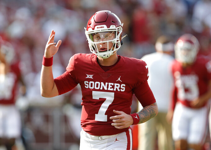 Oklahoma quarterback Spencer Rattler gestures before the team's NCAA college football game against Western Carolina on Saturday, Sept. 11, 2021, in Norman, Okla. (AP Photo/Alonzo Adams)