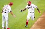 Washington Nationals Howie Kendrick, right, rounds the bases after hitting a home run during the first inning of a baseball game against the New York Mets in Washington, Tuesday, Aug. 4, 2020. (AP Photo/Manuel Balce Ceneta)