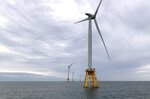 FILE - In this Aug. 23, 2019, file photo, Deepwater Wind's turbines stand in the water off Block Island, R.I. Massachusetts is poised to its next step in battling climate change. A landmark law signed by Gov. Charlie Baker in March 2021 has officially taken effect. A key goal of the new law is creating a net-zero greenhouse gas emission limit by 2050. The law also requires the creation of an additional 2,400 megawatts of offshore wind. (AP Photo/Rodrique Ngowi, File)
