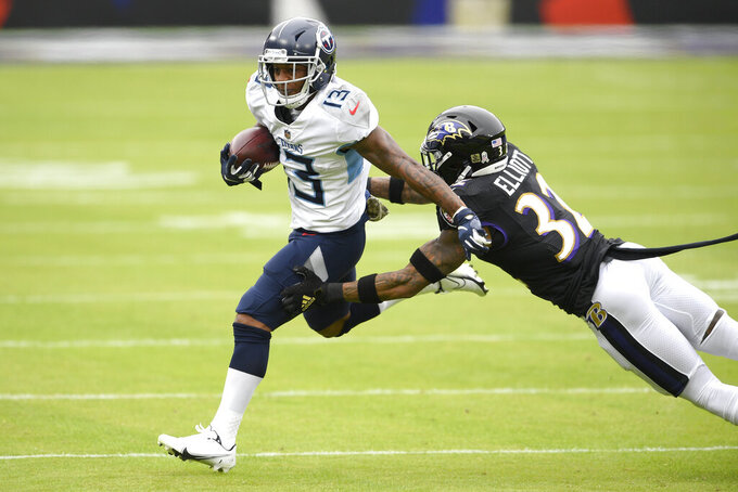 Tennessee Titans wide receiver Cameron Batson (13) avoids a tackle by Baltimore Ravens strong safety Chuck Clark (36) during the first half of an NFL football game, Sunday, Nov. 22, 2020, in Baltimore. (AP Photo/Nick Wass)