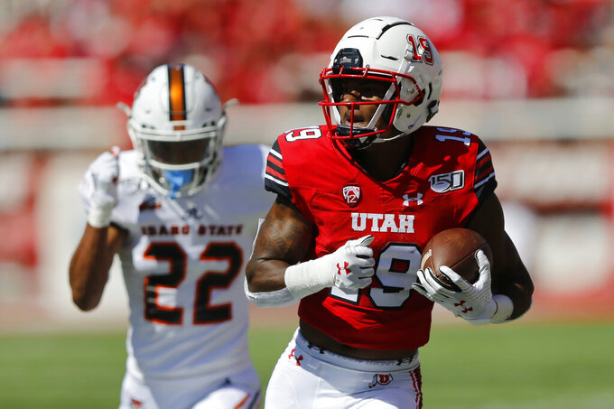 Utah wide receiver Bryan Thompson (19) catches a touchdown pass against Idaho State defensive back Caleb Brown (22) in the first half of an NCAA college football game Saturday, Sept. 14, 2019, in Salt Lake City. (AP Photo/Rick Bowmer)
