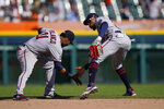 Minnesota Twins second baseman Jorge Polanco (11) and center fielder Byron Buxton celebrate the team's 3-2 win over the Detroit Tigers in a baseball game, Monday, Aug. 30, 2021, in Detroit. (AP Photo/Carlos Osorio)