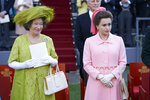 In this image released by Netflix, Marion Bailey portrays Queen Elizabeth the Queen Mother, left, and Helena Bonham Carter portrays Princess Margaret in a scene from the third season of