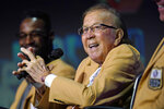 Tom Flores answers a question as members of the Pro Football Hall of Fame Class of 2021 participate in an enshrinees roundtable in Canton, Ohio, Sunday, Aug. 8, 2021. (AP Photo/Gene J. Puskar)