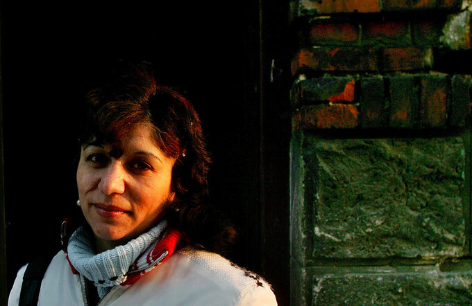 FILE - In this file photo dated Monday, Jan. 16, 2006, Elena Gorolova poses in Ostrava, Czech Republic. Dozens of roma women, including Gorolova were illegally sterilized in Sept. 1990, according to findings by the country's ombudsman.  The lower house of Czech Parliament on Friday June 4, 2021, has approved legislation to compensate Roma women sterilized against their will. (AP Photo/Petr David Josek, FILE)
