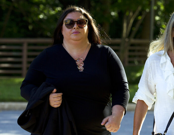 Lee Elbaz arrives at federal court for jury selection in her trial in Greenbelt, Md., Tuesday July 16, 2019. Elbaz was CEO of an Israel-based company called Yukom Communications. She is accused of engaging in a scheme to dupe investors through the sale and marketing of financial instruments known as