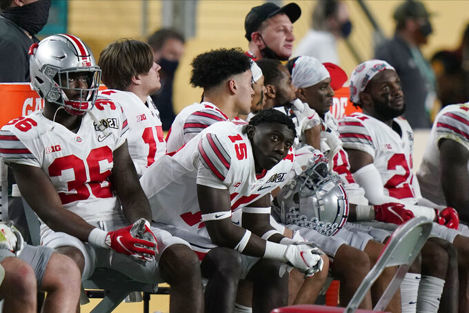 Ohio State players watch from the sidelines during the second half of an NCAA College Football Playoff national championship game against Alabama, Monday, Jan. 11, 2021, in Miami Gardens, Fla. (AP Photo/Lynne Sladky)