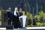 Russian Orthodox Church Patriarch Kirill, center, delivers his speech as Russian President Vladimir Putin, right, and Russian Defense Minister Sergei Shoigu stand near after a religion service marking the 79th anniversary of the Nazi invasion of the Soviet Union, at the Cathedral in the Patriot Park outside Moscow, Russia, Monday, June 22, 2020. The country's new Cathedral of Russian Armed Forces was built and dedicated to the Soviet victory in World War II. (Alexei Nikolsky, Sputnik, Kremlin Pool Photo via AP)