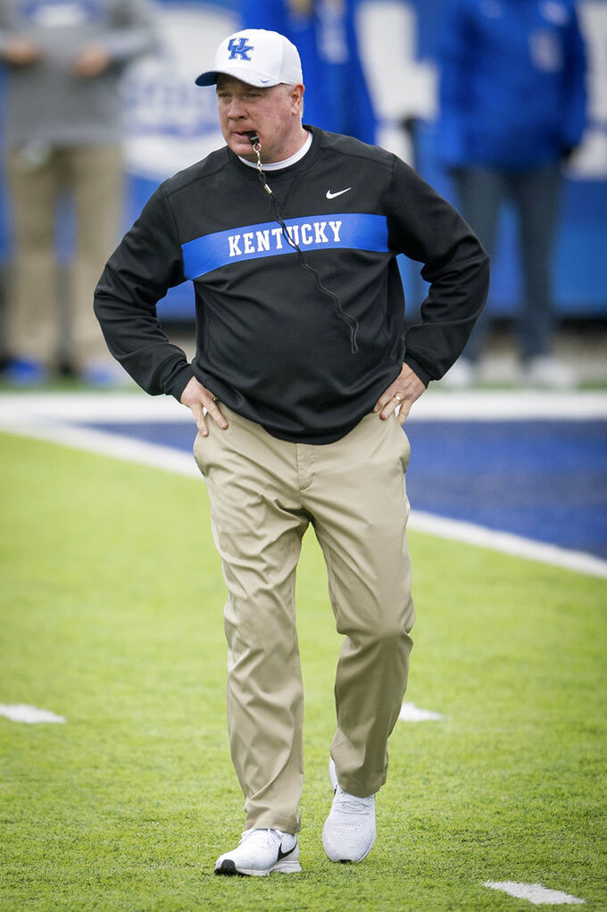 Kentucky head coach Mark Stoops stands before an NCAA college football game against Middle Tennessee in Lexington, Ky., Saturday, Nov. 17, 2018. (AP Photo/Bryan Woolston)