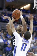 Butler's Sean McDermott (22) shoots against Creighton's Marcus Zegarowski (11) during the first half of an NCAA college basketball game in Omaha, Neb., Sunday, Feb. 23, 2020. (AP Photo/Nati Harnik)