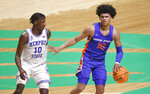 Boise State guard RayJ Dennis (10) handles the ball as Memphis guard Damion Baugh (10) defends during the first half of an NCAA college basketball game in the semifinals of the NIT, Thursday, March 25, 2021, in Denton, Texas. (AP Photo/Ron Jenkins)