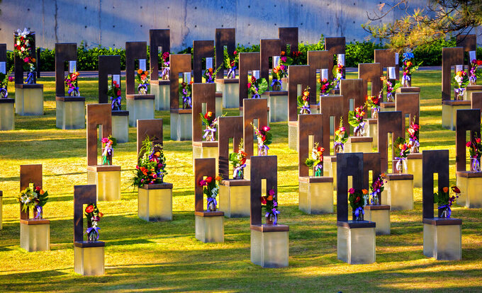 Flowers decorate the memorial chairs in the Field of Chairs for the 26th Anniversary Remembrance Ceremony at the Oklahoma City National Memorial and Museum in Oklahoma City, Okla on Monday, April 19, 2021. (Chris Landsberger/The Oklahoman via AP)