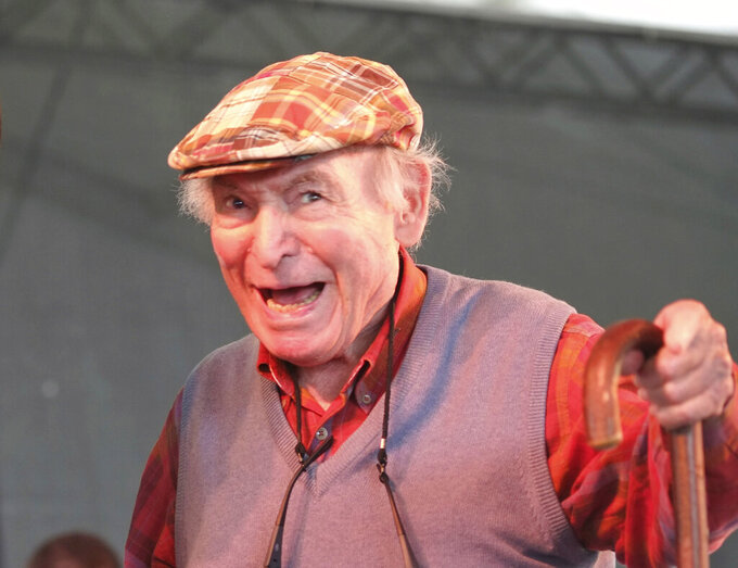 FILE - In this Aug. 4, 2013, file photo, Newport Jazz Festival producer and founder George Wein appears on stage at the Newport Jazz Festival in Newport, R.I. Wein, an impresario of 20th century music who helped found the Newport Jazz and Folk festivals and set the template for gatherings everywhere from Woodstock to the south of France, died Monday, Sept. 13, 2021. He was 95. (AP Photo/Joe Giblin, File)