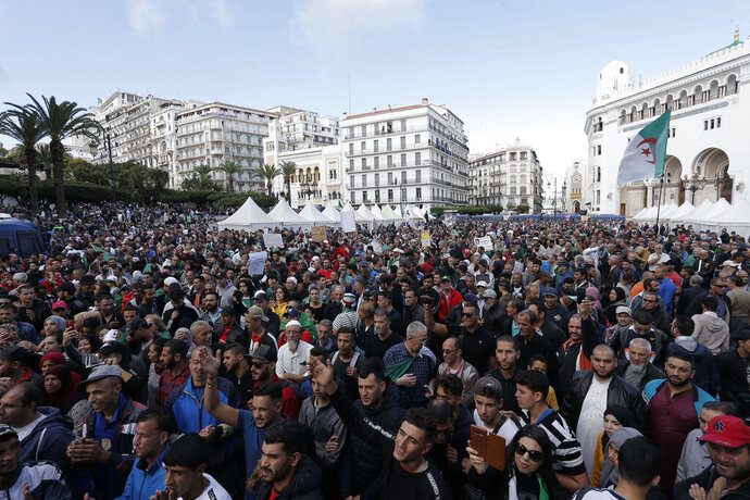 In this photo taken on Friday, Oct. 25, 2019, demonstrators take to the streets in the capital Algiers to protest against the government. (AP Photo/Toufik Doudou)