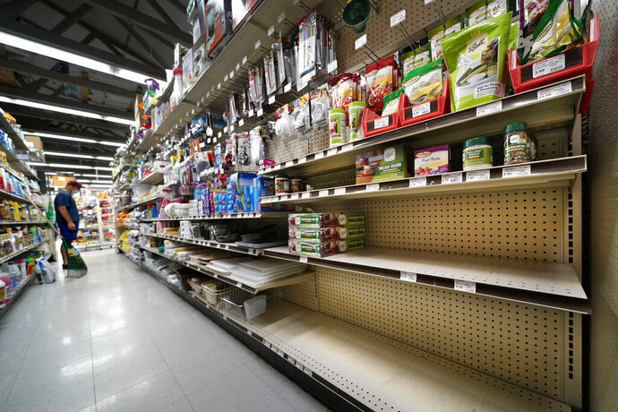 Shelves that are usually stocks with Mason jars and lids in the canning supply section are mostly empty at the Drillin True Value hardware store, Friday, Sept. 4, 2020, in South Portland, Maine. During this ongoing coronavirus pandemic many retailers have been frustrated by the scarce supply of jars and lids used for canning vegetables. (AP Photo/Robert F. Bukaty)